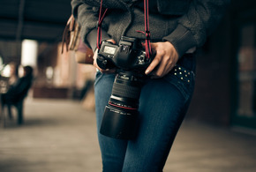 Woman photgrapher with camera jpg