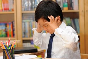 Frustrated asian schoolboy in school uniform doing homework shutterstock 800x430 jpg