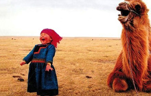 Girl and laughing camel1 jpg